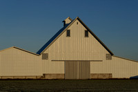 A modern barn with clean, graphic lines.