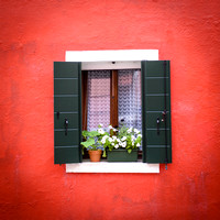 Burano window green shutters orange wall