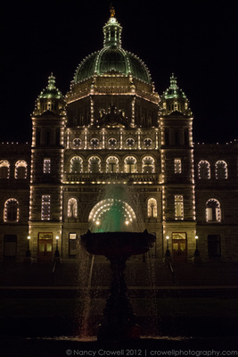 Colorful fountain in front of Victoria, BC Parliament house, night time. (c) Nancy K. Crowell | Crowell Photography