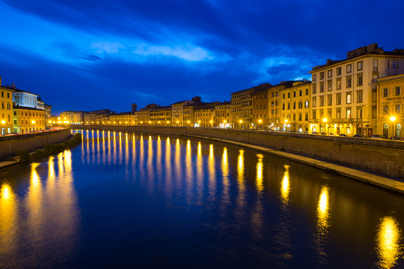 The Arno river in Pisa, Italy at night.