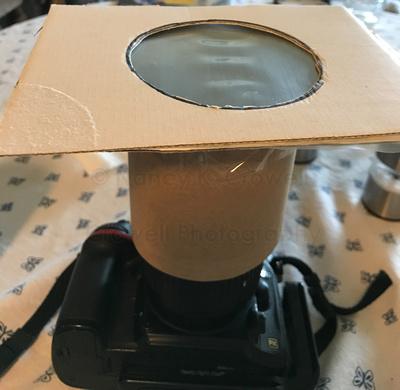 Image of homemade solar filter slipped over lens.