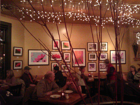 La Conner Brewery hums with people. My images are on the wall.