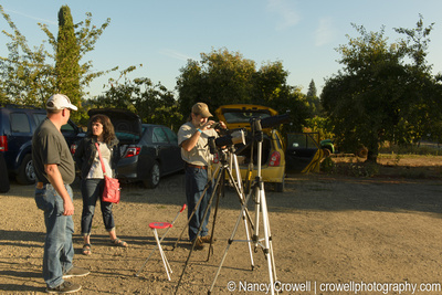 Image of three people and cameras on tripods.